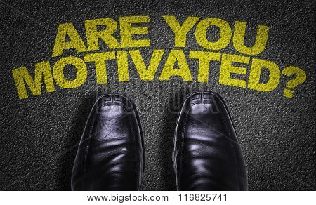 Top View of Business Shoes on the floor with the text: Are You Motivated?