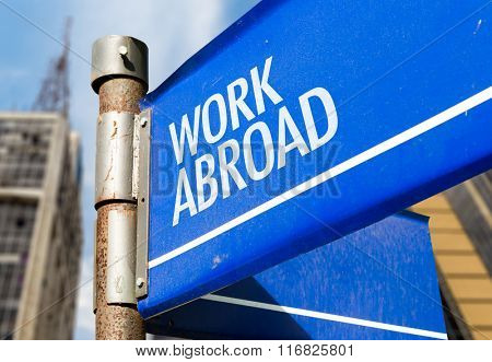 Work Abroad written on road sign