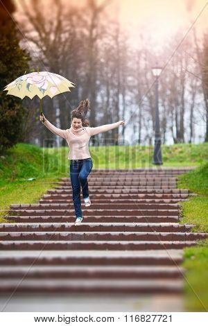 Happy Girl With Unbrella