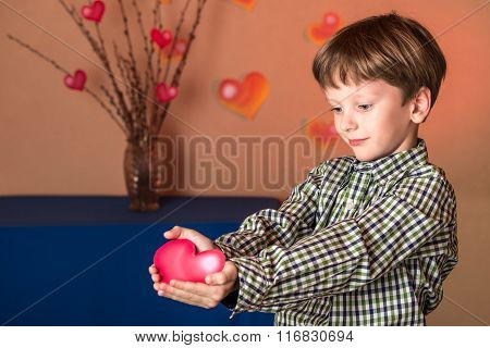 Boy Gives A Pink Heart On Valentines Day.