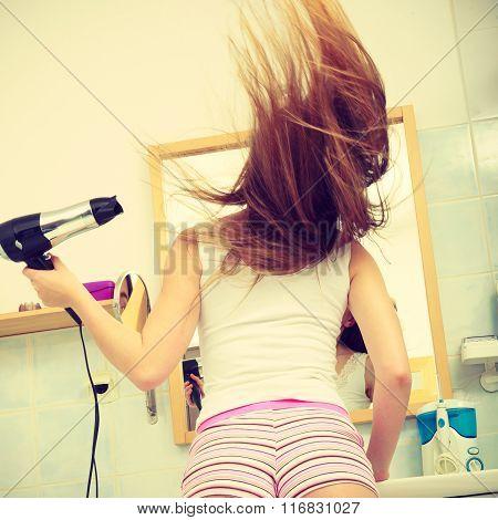 Long Haired Woman Drying Hair In Bathroom. Haircare.