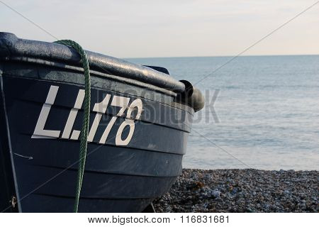Bognor Regis, Sussex, UK- 10th Jan 2016: Wooden Fishing Boat On A Pebble Beach