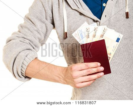 Tourist Holding Passport Full Of Money.