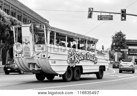 Ride The Ducks Amphibious Bus Riding Down The Street