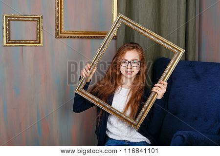 Teen Girl With Glasses Holding An Empty Picture Frame.
