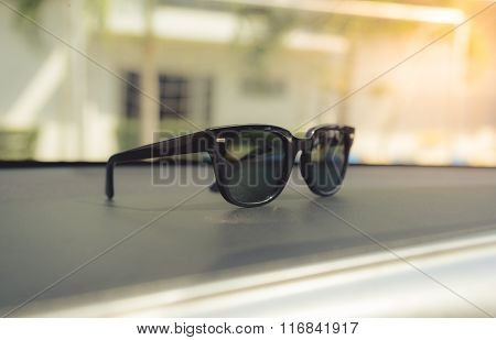Concept Vintage Of Sunglasses On The Console Car. Selective Focus.