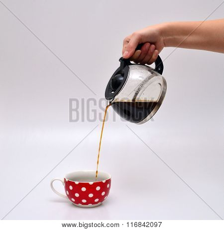Woman Hand Pouring Coffee In A Mug