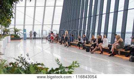 LONDON, UK - APRIL 30, 2015:  People in the glass hall of Walkie-Talkie garden, watching London