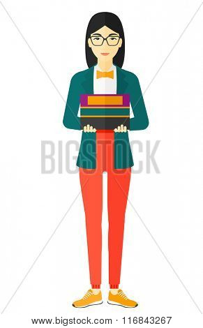 Woman holding pile of books.