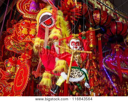 Chinese lunar new year ornaments toy of monkey on festive background,words mean best wishes and good luck for the coming chinese new year