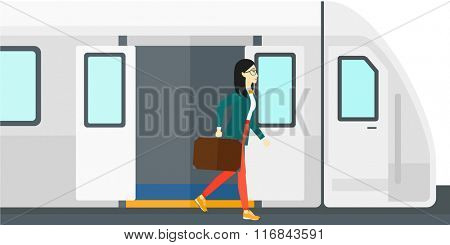 Woman going out of train.