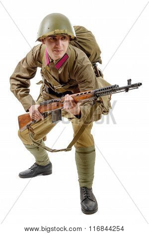 Young Soviet Soldier With Svt Rifle On The White Background