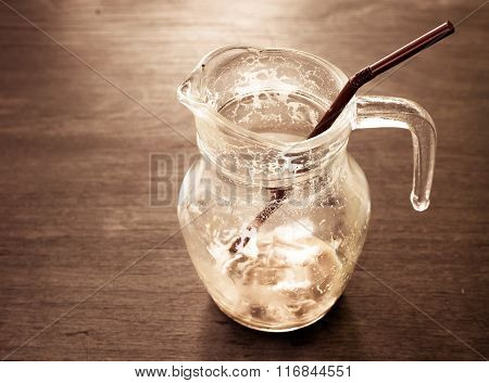 A Empty Cup Of Iced Caramel Cappuccino Coffee In A Transparent Cup On Wooden Background. Vintage Ton