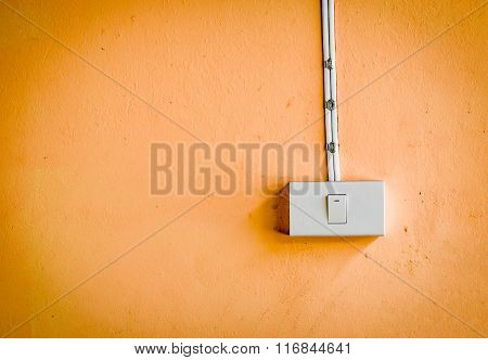 Electronic Switch On Orange Color Wall
