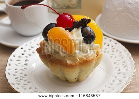 Cake With Cream And Cherries In A Basket