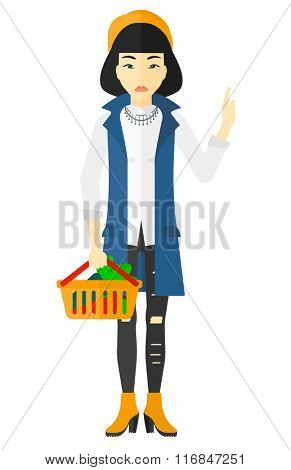 Woman holding supermarket basket.
