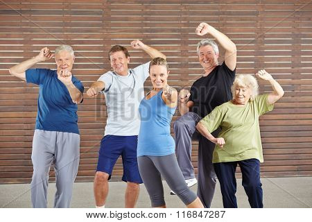 Active seniors with power and energy in gym learning self defense