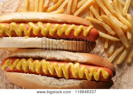 Hot dogs and fried potatoes closeup