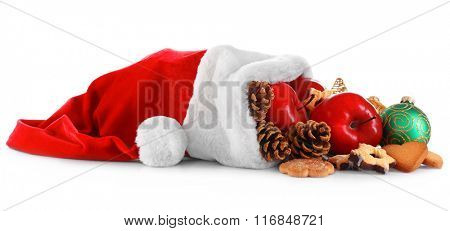 Santa hat filled with Christmas gifts, isolated on white