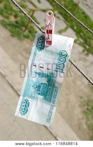 thousand rubles hanging on  rope