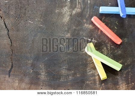 Colored Chalk On The Wooden Nature Board