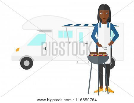 Woman preparing barbecue.