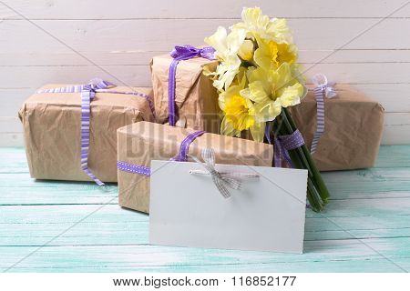 Yellow daffodils flowers wrapped gift boxes and empty tag