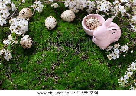 Easter Background. Egg, Spring Flowering Tree Branches And Decorative Rabbit   On Green Moss Backgro