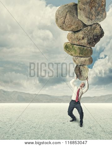 man hold lots of big stone concept of stress
