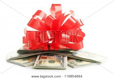 Dollars and big red bow isolated on white
