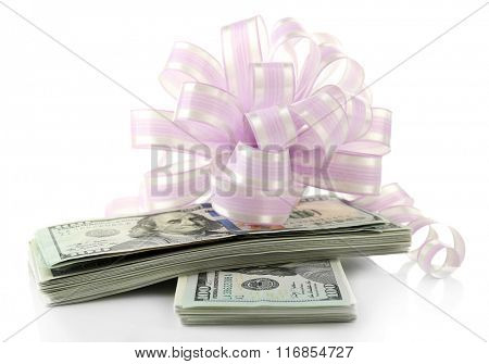 Dollars and big pink bow isolated on white