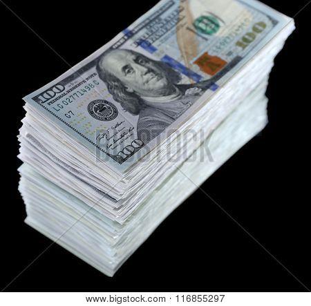 Stack of dollar banknotes on black background