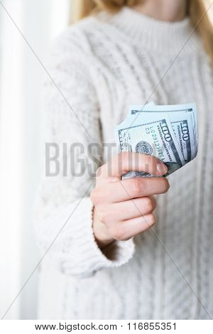 Hand holds money, close up