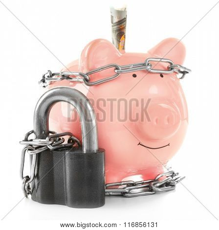 Piggy bank and chains isolated on white