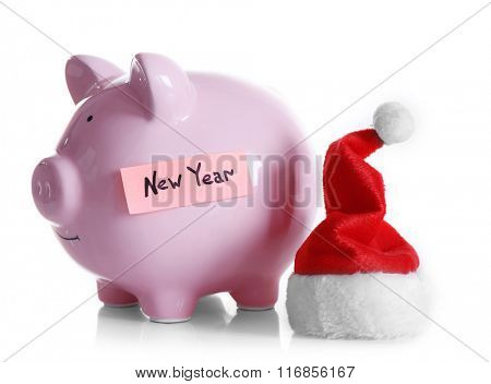 Piggy bank with Santa hat isolated on white
