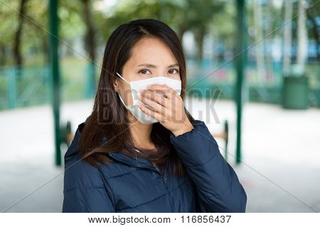 Woman wearing face mask to protect against disease
