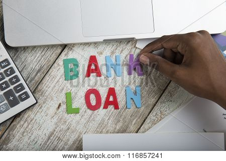Hand Arrange Wood Letters As Bank Loan Word