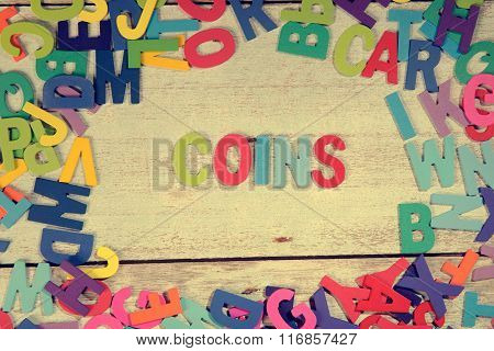 Coins Word Block Concept Photo On Plank Wood