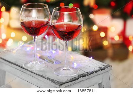 Two glasses of red wine on Christmas decoration background