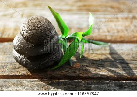 Spa stones with bamboo on wooden background