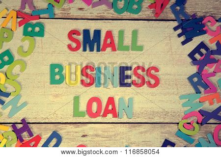 Small Business Loan Word Block Concept Photo On Plank Wood