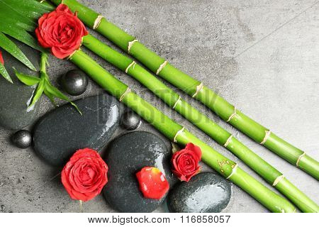 Beautiful spa composition with roses, bamboo and stones