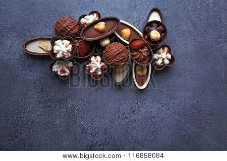 Chocolate sweets on dark grey background
