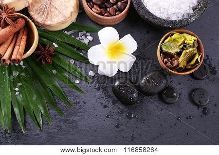 Beautiful spa setting on palm leaf on grey background