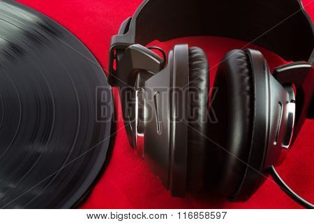 Lp Record And Earphones On Red Felt Surface