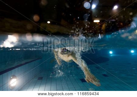 Young man swimming in pool