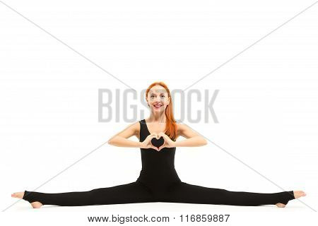 Sporty young woman doing splits yoga asana