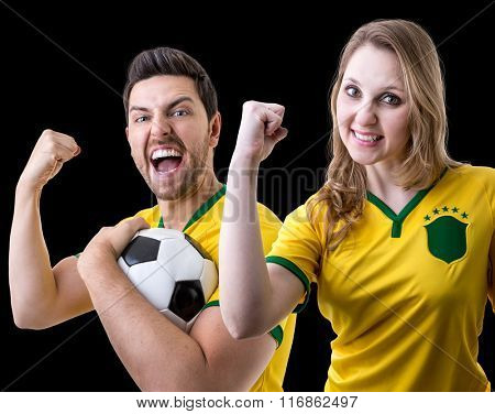 Brazilian couple fan celebrating on black background
