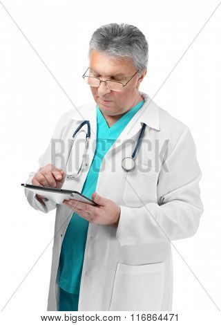 A handsome doctor with stethoscope and tablet, isolated on white