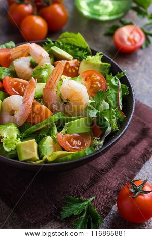 Salad With Avocado And Shrimps In Bowl